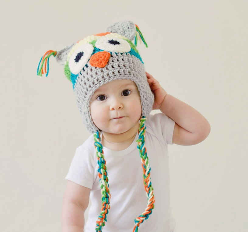 baby boy with owl stocking cap